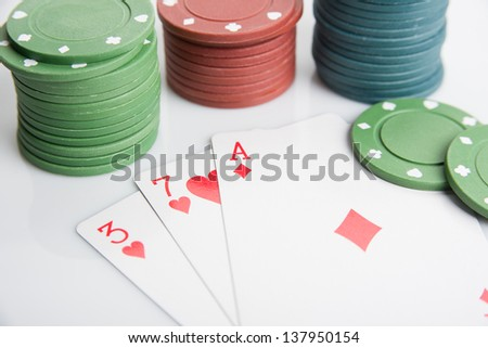Image of ace, seven, three and poker chips stack. Selective focus