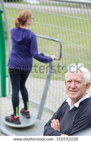 Image of active retired male and female relaxing outdoor - stock photo