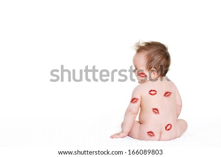 Image of adorable child with red kisses on the skin, happy baby boy sitting down in the studio and isolated on white background, little love angel, romantic holiday, Valentines day concept