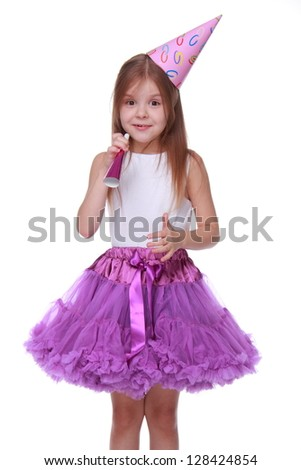 Image of adorable princess for christmas card isolated over white/Girl wearing white top and bright purple tutu skirt