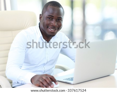 Image of african american businessman working on his laptop. - stock photo