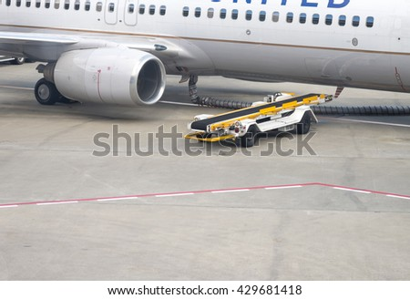Image of aircraft waiting for luggage loading at the airport for transportation background with selective focused point  - stock photo