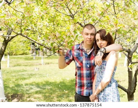 Image of an attractive young couple in love posing with the tree while on an outdoor date together. - stock photo