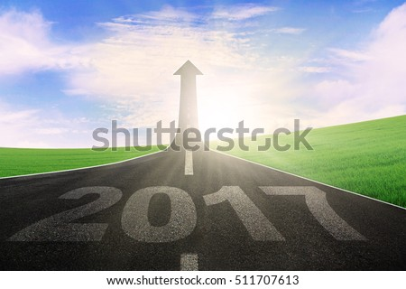 Image of an empty highway with number 2017 and upward arrow. Symbolizing better future