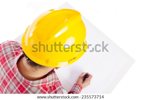 Image of an engineer sketching a plan, isolated on white background - stock photo