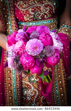 Image of an Indian brides hands holding bouquet