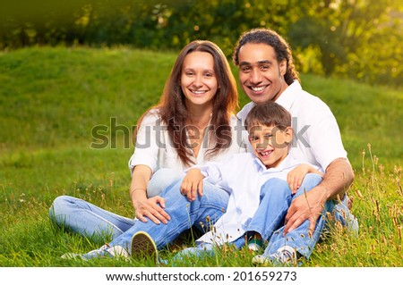 Image of an international family sitting together in the park