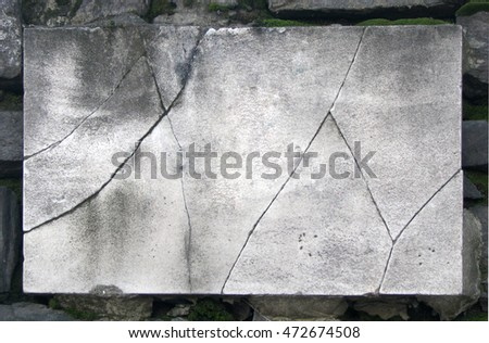 Image of an old and broken marble sign board