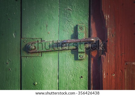 Image of an old barn door with iron clasp.