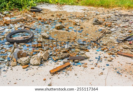 image of An old tyre in a broken glass zone for background usage.