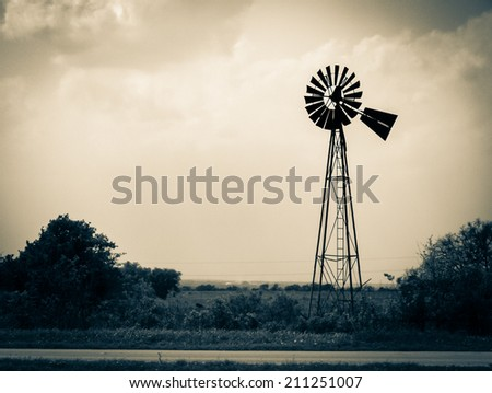 Image of an old weathered windmill out west