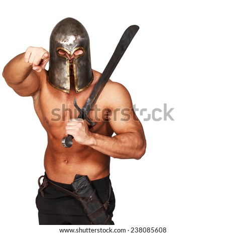 Image of angry warrior with sword who is pointing on someone - stock photo