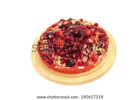 Image of appetizing berry tart on cutting board, isolated over white background - stock photo