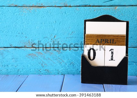 image of April First wooden vintage calendar on white background  - stock photo