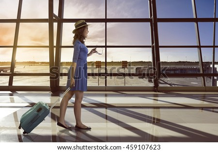 Image of asian woman travel alone carry suitcase in the airport