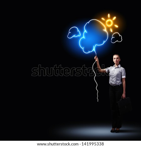 Image of attractive businesswoman against dark background