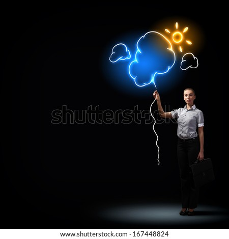 Image of attractive businesswoman against dark background with sun - stock photo