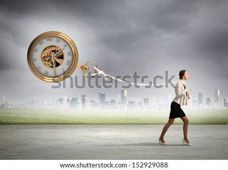Image of attractive businesswoman and pocket watch. Time for business - stock photo