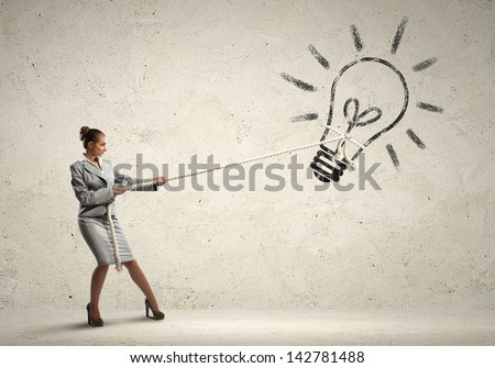 Image of attractive businesswoman pulling rope with idea symbol - stock photo