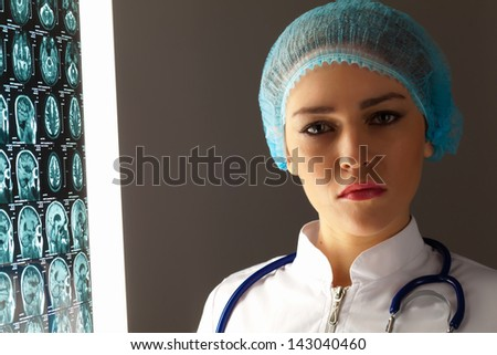 Image of attractive woman doctor in x-ray laboratory - stock photo