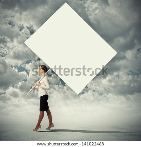 Image of attractive woman holding blank board. Place for text - stock photo
