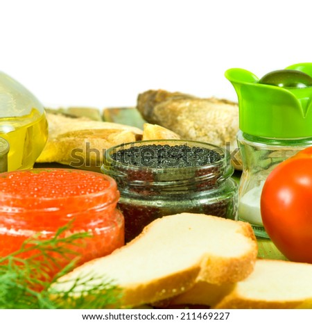 image of bank with red and black caviar, bread and herbs on a white background