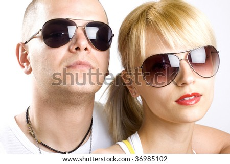 Image of beautiful casual couple with sunglasses on