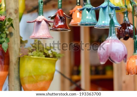 image of beautiful colorful ceramic bells in row decoration on market fair - stock photo