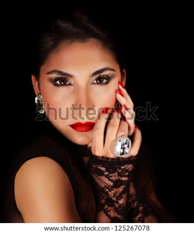 Image of beautiful woman with red sexy lips, closeup portrait of gorgeous female isolated on black background, seductive female wearing luxury diamond jewelery, passion and glamor concept - stock photo