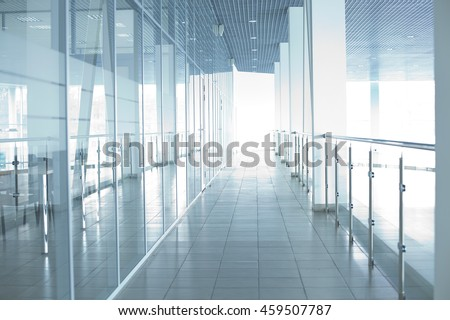 Image of big windows passing daylight inside office building. Sunny on modern glass windows building interior corridor
