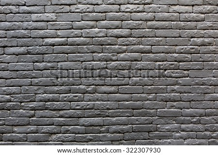 Image of black brick wall background - stock photo
