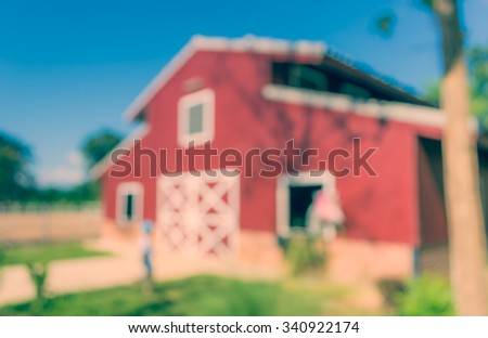 image of blur barn on sunny day  for background usage . (vintage tone) - stock photo