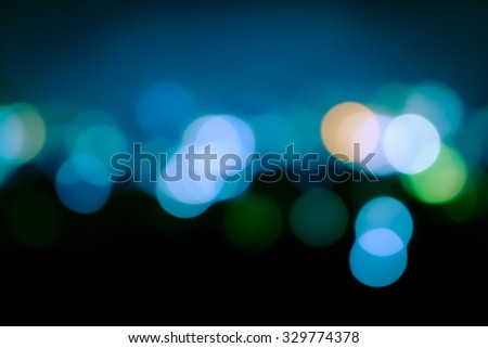 image of blur bokeh light in city in blue tone
