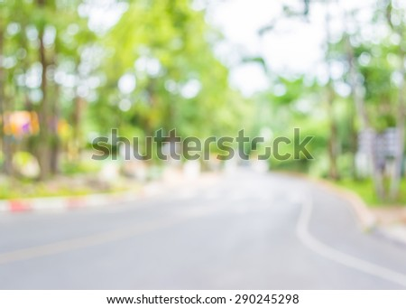 image of blur car on the road with bokeh for background usage. - stock photo