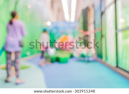 image of blur kid at science museum for background usage .