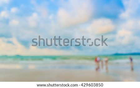 image of blur people walking on the beach for background usage .