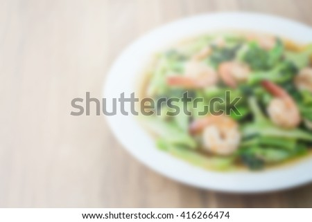 image of blur stir fried broccoli with shrimp.for background usage. - stock photo