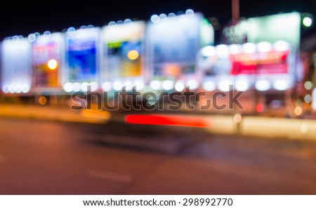 image of blur street  and billboard  with warm colorful lights in night time for background usage . - stock photo