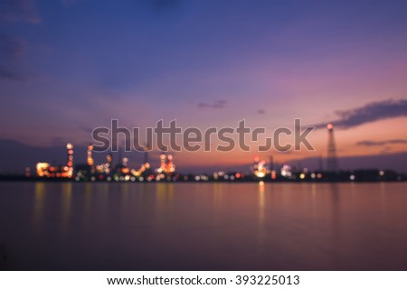Image of blurry Refinery plant with real water reflection in Bangkok