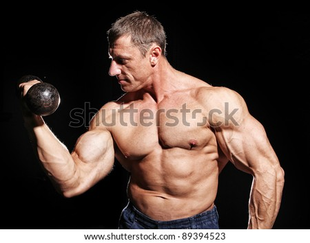 Image of bodybuilder showing his  muscular body - stock photo