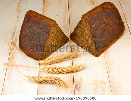 image of  bread and wheat on the wooden table