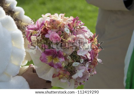 Image of bridal bouquet in bridals hands - stock photo