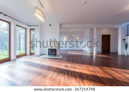 Image of bright empty living room with wooden floor - stock photo