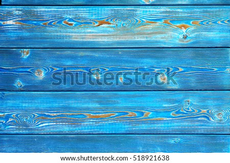 Image of bumpy vintage wooden background painted with bright blue paint