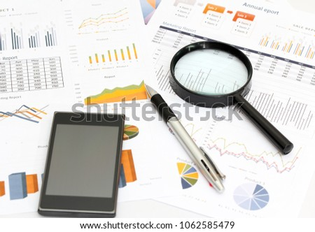 Image of business and report with graph and chart on white paper