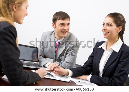 Image of business group discussing new project or plan in the office