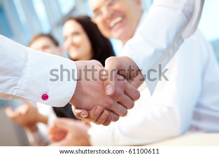 Image of business handshake after signing new contract - stock photo
