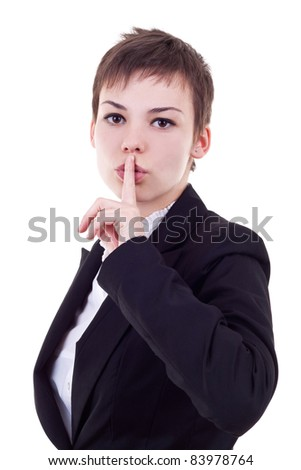 Image of business lady in suit holding her finger near the mouth