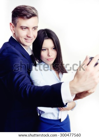 Image of business partners discussing documents and ideas at meeting. Work process of business meeting with electronic devices in office. - stock photo
