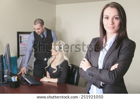 Image of business partners discussing documents and ideas at office - stock photo